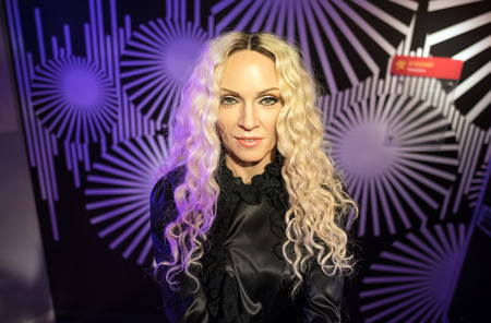 celebes: BANGKOK-JAN 29:: A waxwork of Madonna on display at Madame Tussauds on January 29, 2016 in Bangkok, Thailand. Madame Tussauds newest branch hosts waxworks of numerous stars and celebrities Editorial