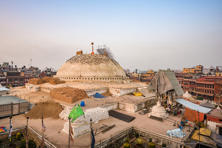 stupa one: KATHMANDU,NEPAL- DEC18, 2015: Boudhanath stupa structural damages after the 7.8 earthquake hit Nepal during April 25th in Kathmandu, Nepal., Boudhanath is one of the largest ancient stupa in the world Editorial