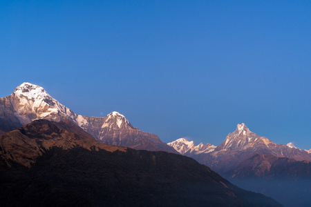 fishtail: Machapuchare or Fishtail peak with sunrise sky. it is a mountain in the Annapurna Himal of north central Nepal.