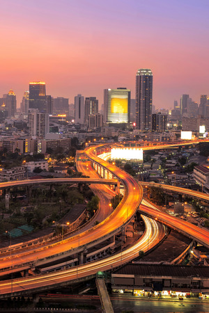 Modern office buildings, condominium in big city downtown with Motorway, Expressway, Freeway the infrastructure for transportation in modern city, urban view at twilight time 스톡 콘텐츠