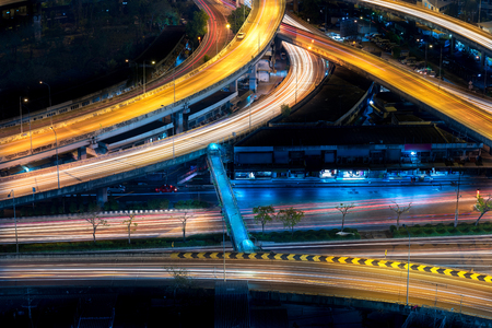 tollway: Motorway, Expressway, Freeway the infrastructure for transportation in modern city, urban view at night time Stock Photo