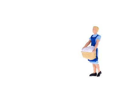 wicker work: Close up of Miniature people isolate on white background. Elegant Design with copy space for placement your text, mock up for laundry and house keeping concept