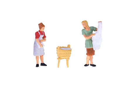 household tasks: Close up of Miniature people isolate on white background. Elegant Design with copy space for placement your text, mock up for laundry and house keeping concept