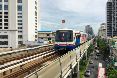 chit: BANGKOK -JUL 26 : The Bangkok Mass Transit System (BTS) running to Mo Chit station on July 26, 2016. BTS is an elevated rapid transit system in Bangkok, Thailand