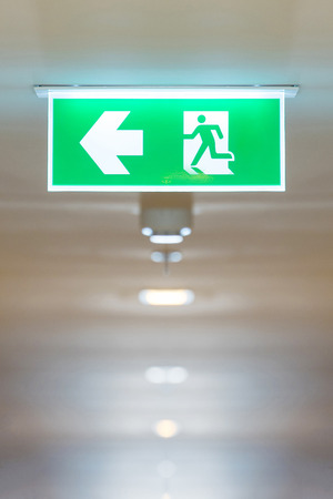 Fire exit sign in high rise building for showing the way to escape when Emergency case occurring