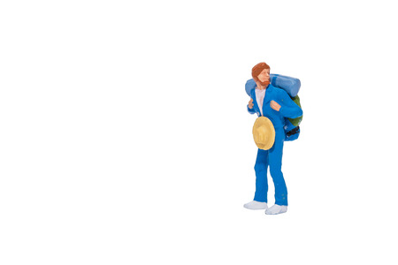 Close up of Miniature backpacker and tourist people isolate on white background. Elegant Design with copy space for placement your text, mock up for travel concept Stock Photo
