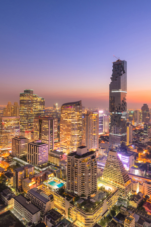 Aerial view over Bangkok modern office business building in business zone at Bangkok, Thailand. Bangkok is the capital and most populous city of Thailand and most populated city in Southeast Asia. Stock Photo