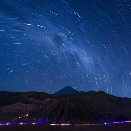 Long exposure capture of star trails above the Bromo Volcano, Indonesia, Astronomy photography.