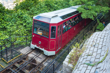 HONG KONG-DEC 02 : Tourists in Victoria Peak Tram on December 02,2017 in Hong Kong.The Peak Tram is the only way to truly experience the beauty of Hong Kongs natural wonders.