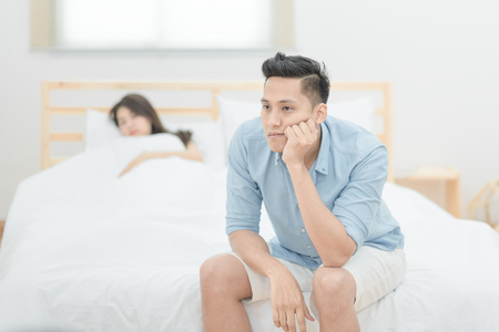 Young asian couple lover having argument and quarrelling with each other.Photo design for family problems and unhappy concept. Stock Photo