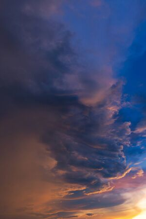 thunderhead: Dramatic sky with storm cloud before raining during sunset. Stock Photo
