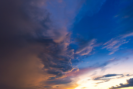 Dramatic sky with storm cloud before raining during sunset. Stock Photo
