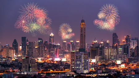 Fireworks light up show on sky over Bangkok City downtown at night,Thailand. Bangkok is the most populated city in Southeast Asia.