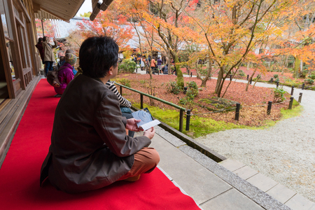 Tourists enjoy watching maple leaf in zen garden at Japanese temple in Kyoto,Japan Editorial