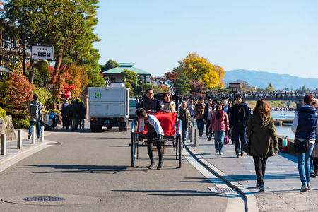 KYOTO,JAPAN-NOV26:Unidentified tourists enjoy walking along Hozu gawa river at Arashiyama in Kyoto on November 26,2106.Arashiyama is a one of attraction landmark for tourists. Editorial