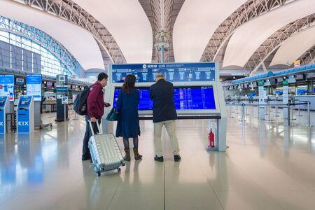 OSAKA,JAPAN-NOV 30: Airline passengers inside the Kansai International Airport on November 30,2016. Kansai International Airport (KIX) is one of Japan's most important international airports.