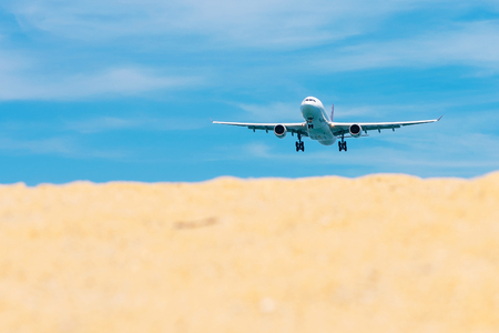 Commercial airplane flying takeoff from international airport with clear sky. Stock fotó