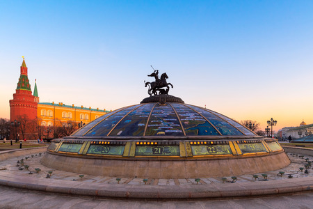 Moscow, Russia-APR14,2018 : Bronze statue of St George in the center glass dome in Manezhnaya Square during sunset on April14,2018 in Moscow, Russia.
