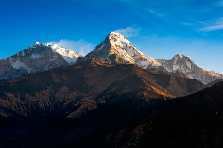 Nature view of Himalayan mountain range at Poon hill view point,Nepal. Poon hill is the famous view point in Gorepani village to see beautiful sunrise over Annapurna mountain range in Nepal