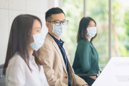 Business employees wearing mask during work in office to keep hygiene follow company policy.Preventive during the period of epidemic from coronavirus or covid19.