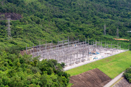Electrical power station with electric Power Transition Line system in mountain area Imagens
