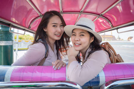 Beautiful asian tourists woman enjoy travel together in urban city downtown on vacation