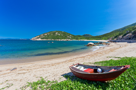 Blue sky blue sea - Sandy Beach with fisher boat photo