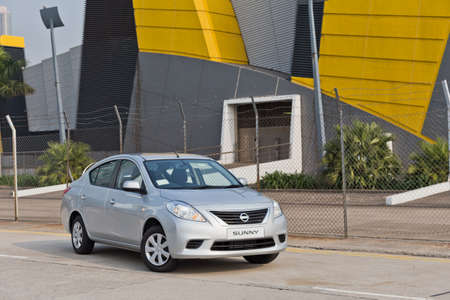 nissan: Nissan Sunny 2013 Model on the road