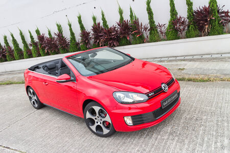 gti: Volkswagen Golf GTI Cabriolet 2013 Model with red colour Editorial