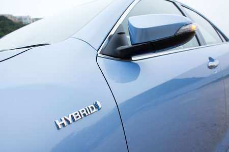 The hybrid logo found on the side of the new Toyota Prius hybrid vehicle. Reklamní fotografie - 26999936