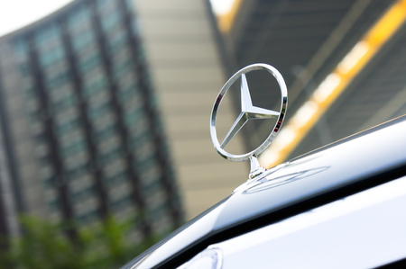 A close-up photo of front part of the Mercedes Benz sedan
