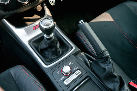 Interior of car, vehicle with visible lever of manual transmission, with metal, chrome elements.