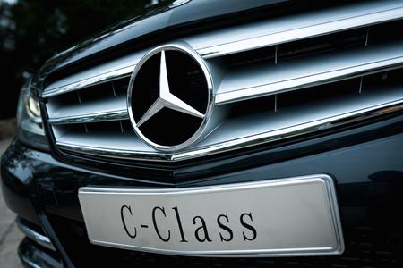 benz: A close-up photo of front part of the Mercedes Benz c-class sedan