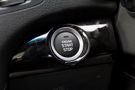 Detail on the start button in a car