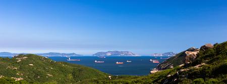 Panorama mountain range in sunny day. boat on sea.