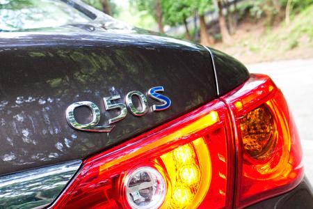 infiniti: Hong Kong, China June 19, 2014 : Infiniti Q50S hybrid sedan logo on June 19 2014 in Hong Kong.