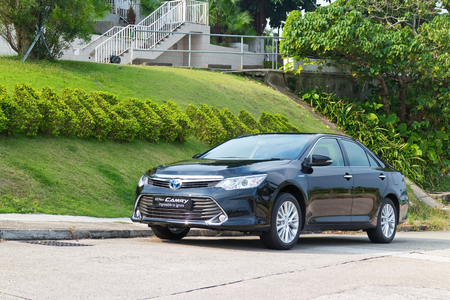 test drive: Hong Kong, China Oct 27, 2014 : Toyota Camry Hybrid 2014 test drive on Oct 27 2014 in Hong Kong. Editorial