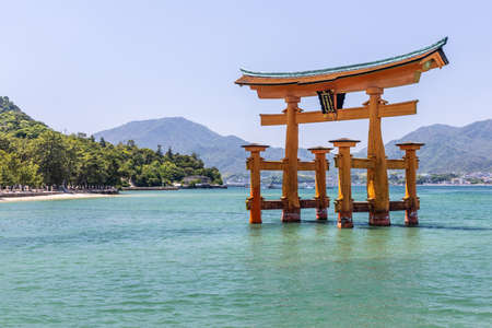 Heron in front of the Floating Tori Gate, Japan