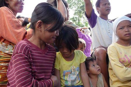 await: Maguindanao, Central Mindanao, Philippines - February 15, 2008 - Children await food at the evacuation center.