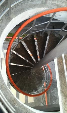 taman: Spiral stair to Taman awam bridge Stock Photo