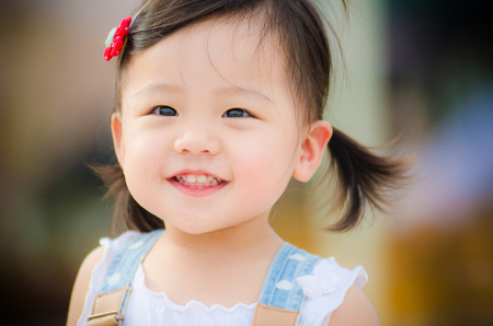 big smile: Lovely Asian little girl with a big smile on her face Stock Photo