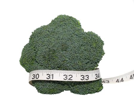 broccoli wrapped in tape measure on white background photo