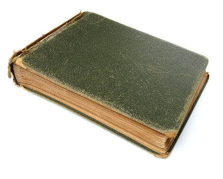 yellowing: an old green photo or stamp album with torn cover and yellowing pages on a white background Stock Photo