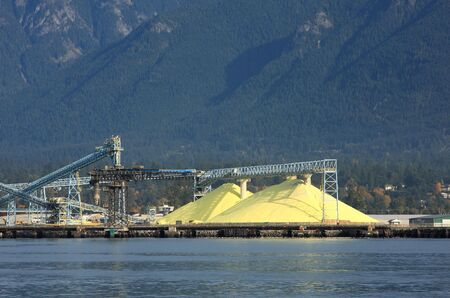 piles of sulphur at a waterfront terminal