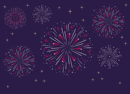 group of fireworks exploding in dark sky
