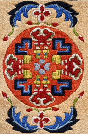 Brightly colored oriental carpet with traditional Tibetan pattern