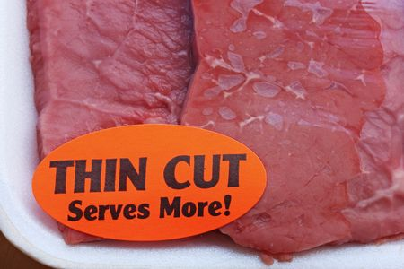 serves: red meat in package with orange label reading thin cut serves more