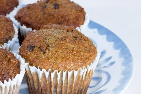 tasty fruit and fibre muffins on plate