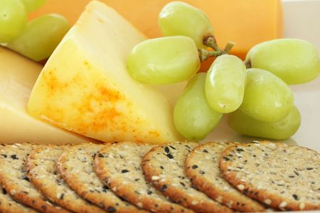 cheese and crackers with green grapes