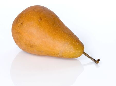 whole bosch pear on light grey background with faint reflection